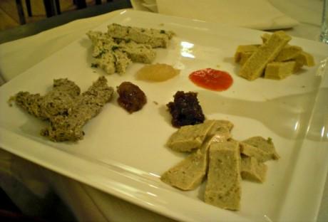 Vegan cheese sampler platter with fruit chutneys.