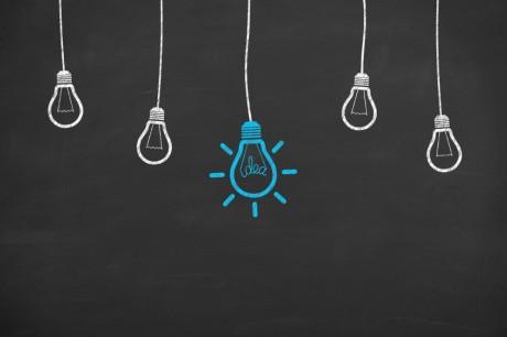 Idea-Light-Bulb-Concept-Drawing-Working-on-Blackboard-000071445887_Small